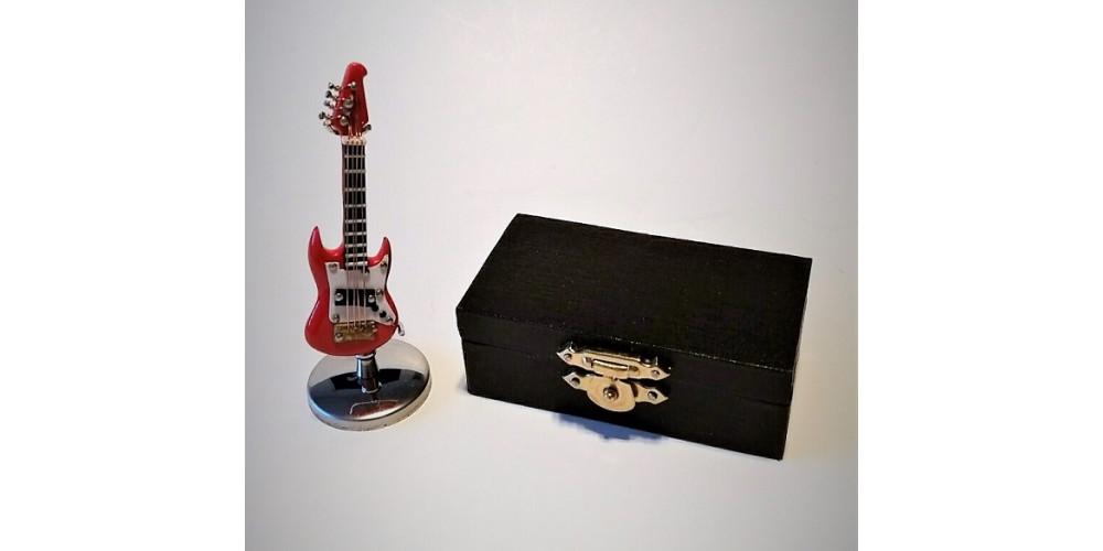 mini guitare lectrique rouge 3 1 100. Black Bedroom Furniture Sets. Home Design Ideas